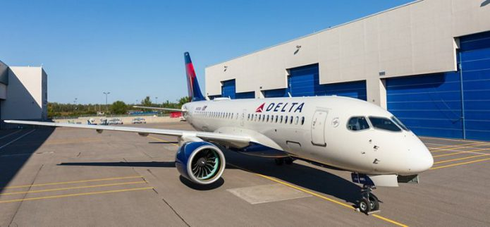 First Delta A220 rolls out of paintshop in Mirabel