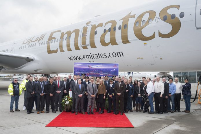The Emirates and Boeing delivery teams celebrate the delivery of the last Boeing 777 300ER A6 EQP